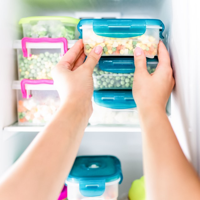 Women putting away freezer meals